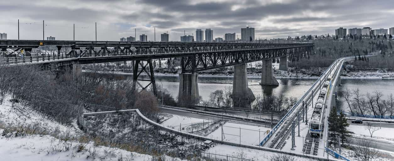 High Level Bridge and Dudley B. Menzies bridge span over the North Saskatchewan River in Edmonton, Alberta, Canada. Taken during a cold and cloudy winter day on November 5, 2018.