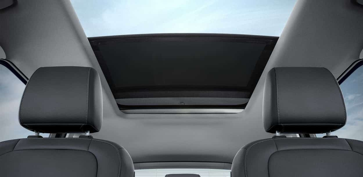 The interior of the Ford Escape with black leatherette seats and the panoramic Vista Roof