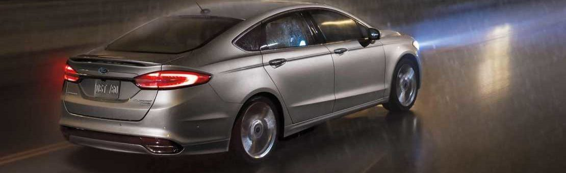 2019 Ford Fusion in grey driving in the rain