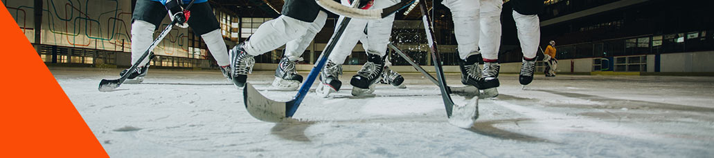 worms eye view of ice hockey rivals having a match in a rink