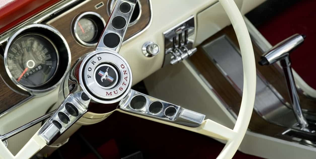 1964 Ford Mustang interior with white steering wheel on display at the annual Wheels Day auto show