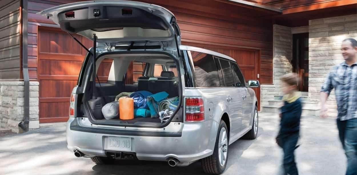 The 2019 Ford Flex Limited in Ingot Silver showing an open trunk.