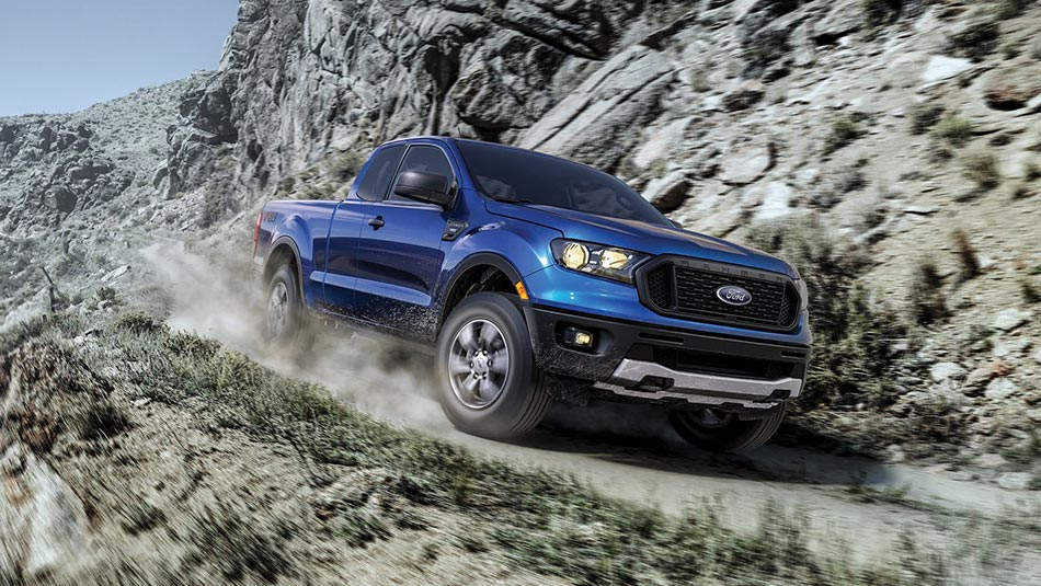 2019 Ford Ranger driving on a rocky mountain path