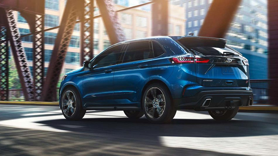 2019 Ford Edge ST driving across a urban bridge