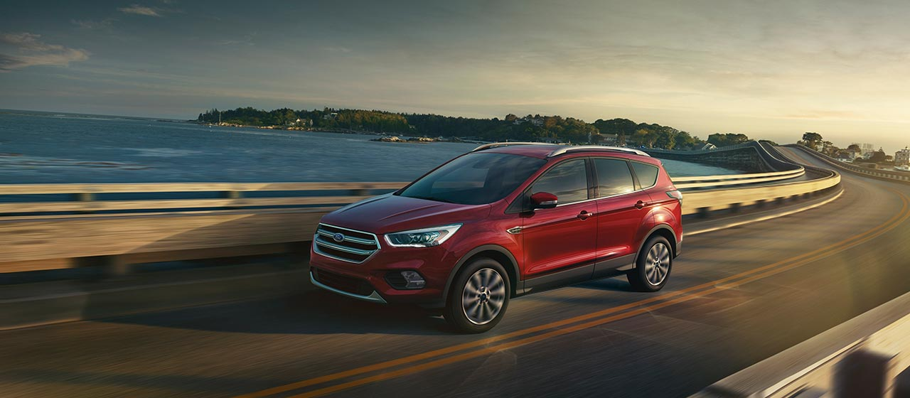 2019 Ford Escape driving on a bridge overpass