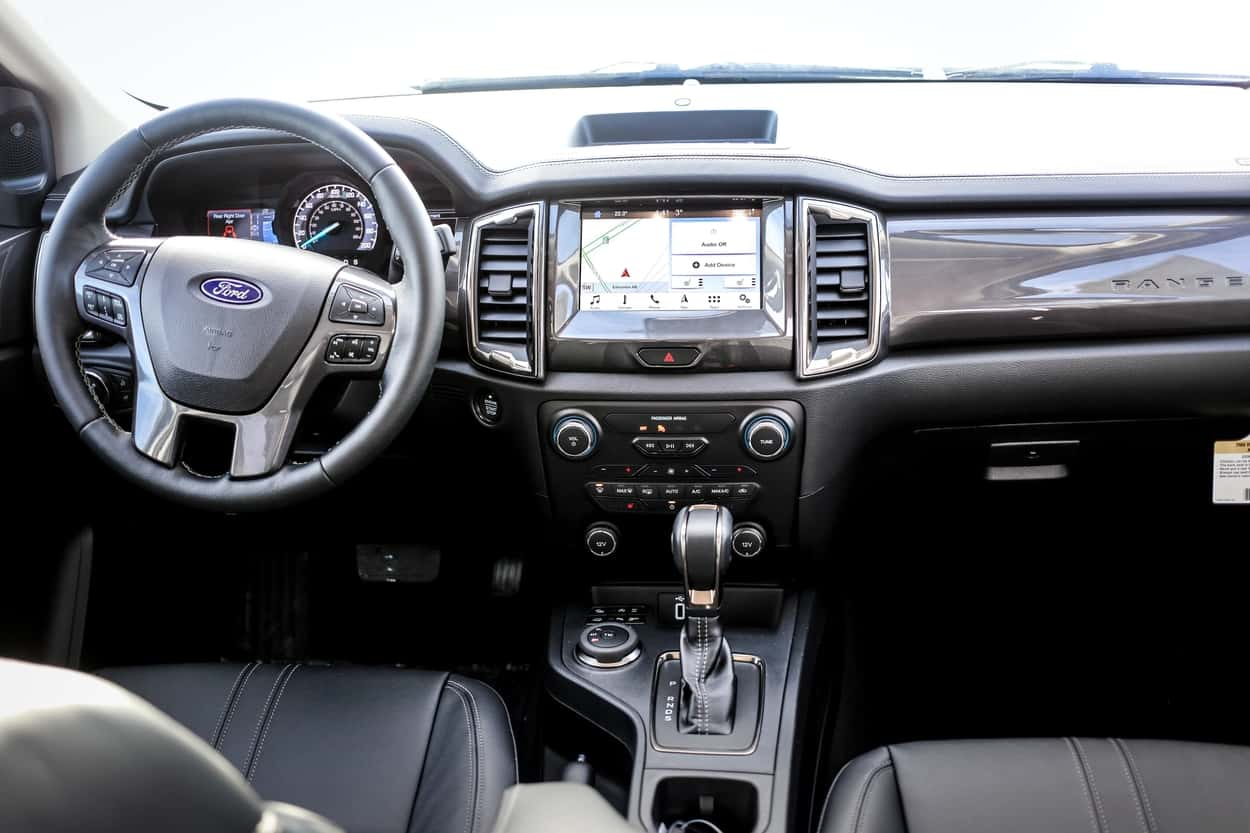 Black leather interior of the 2019 Ford Ranger Lariat with SYNC 3 and 8-inch touchscreen