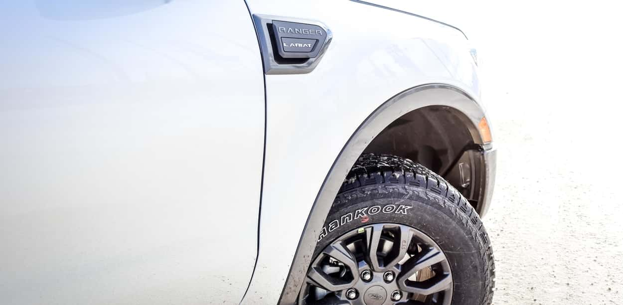 Badge and tires of the 2019 Ford Ranger Lariat in white