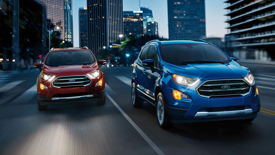 2019 Ford Ecosport exterior view featuring two Ecosports side by side driving down city streets