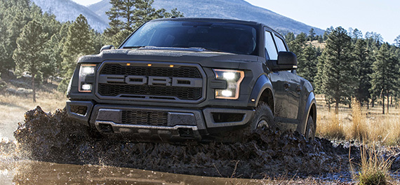 the 2019 ford f-150 raptor plowing through mud