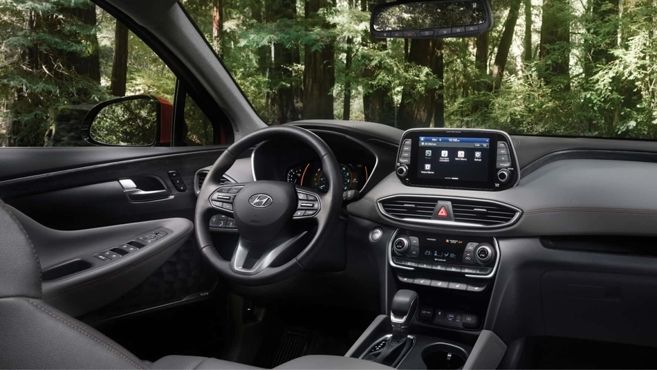 The stylish interior of the 2019 Hyundai Santa Fe, from the rear passenger side