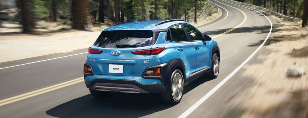 blue 2020 hyundai kona on highway