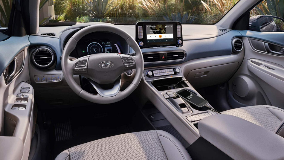 Interior view of a 2019 Hyundai Kona Electric, featuring the driver side dashboard and steering wheel