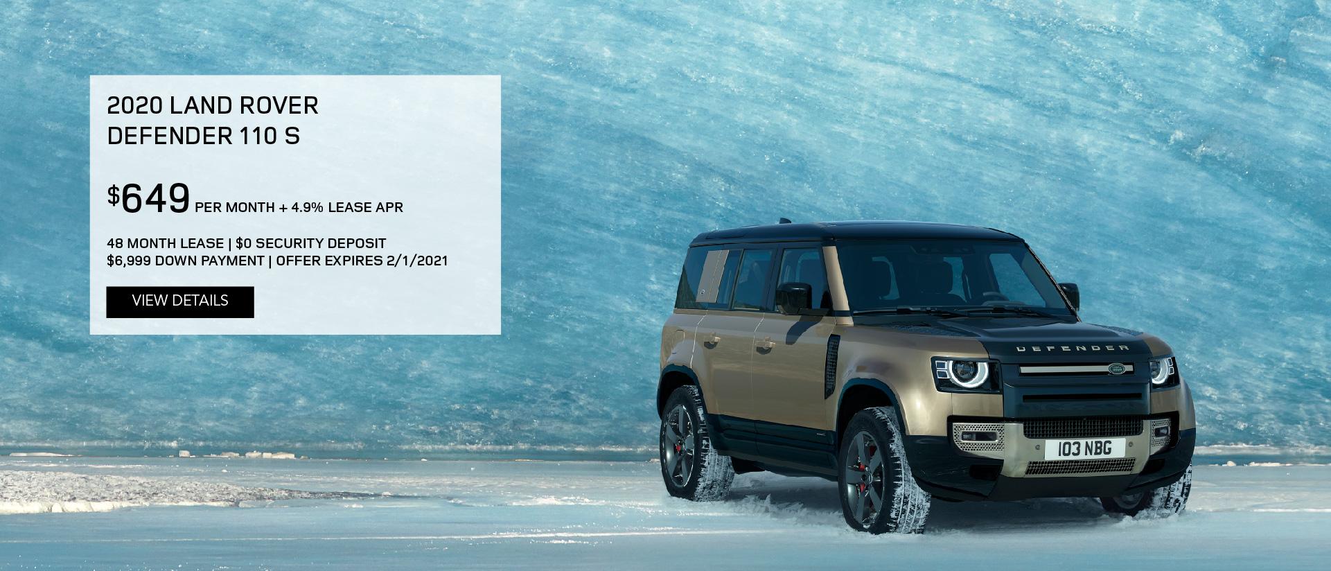 2020 Land Rover Defender on snowy landscape in front of iceberg.
