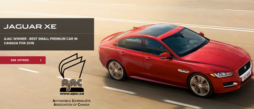 Red Jaguar XE Sedan Driving down Highway