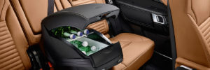 Land Rover black leather warmer/cooler accessory sits strapped-in to the middle of the back seat