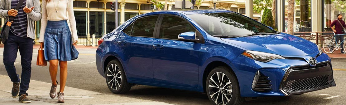 Corolla SE with Upgrade Package shown in Blue Crush Metallic