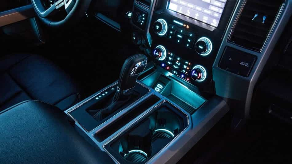 Centre interior console of the 2019 F-150 with ambient lighting
