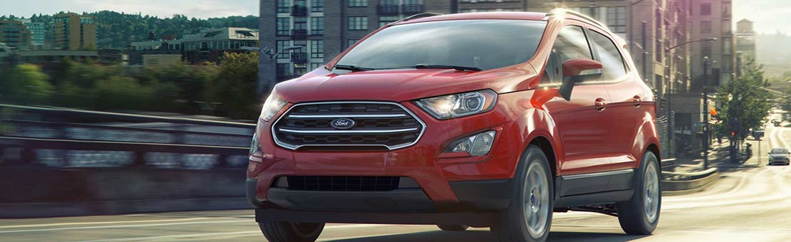 2019 Ford EcoSport SE in Ruby Red cruising along a city street