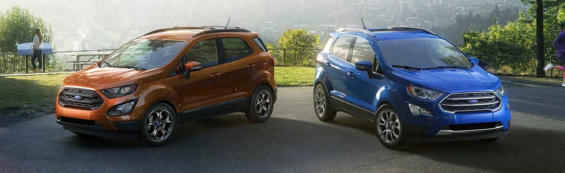 2019 Ford EcoSport SES in Canyon Ridge and Titanium in Lightning Blue parked overlooking a cityscape