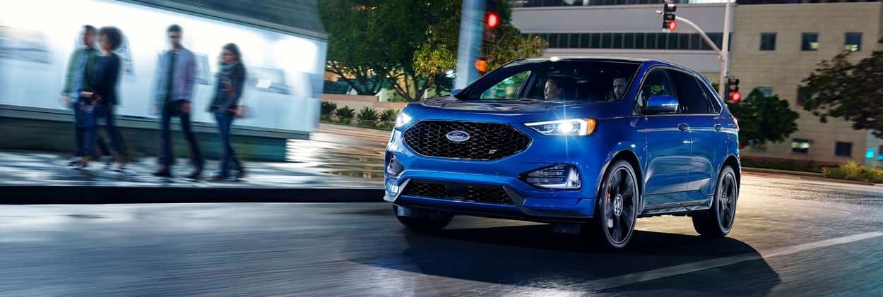 2019 Ford Edge in performance blue driving in the night