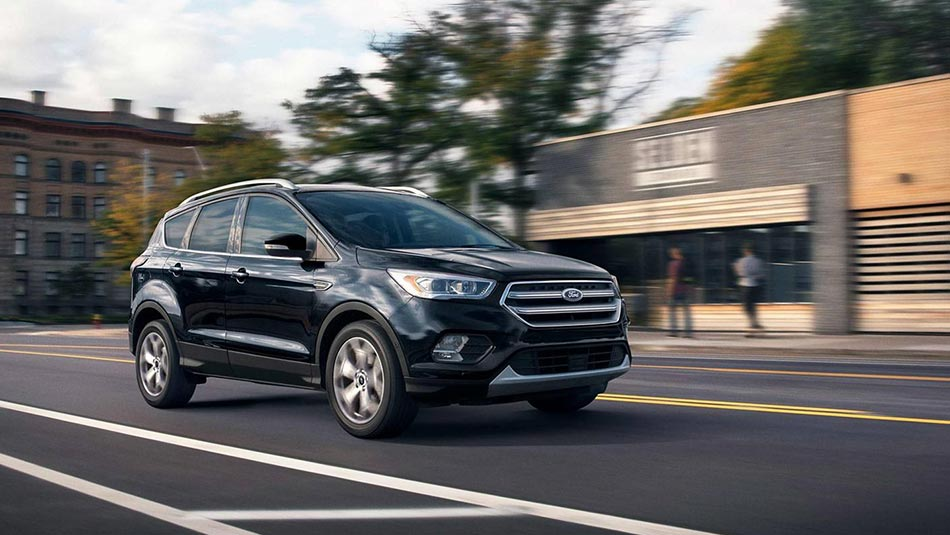 2019 Ford Escape driving down city street