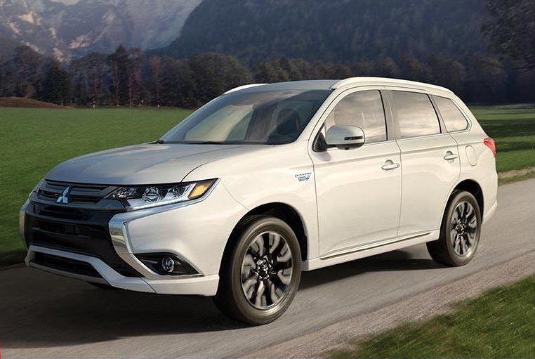 Outlander PHEV on the road with a mountaneous background