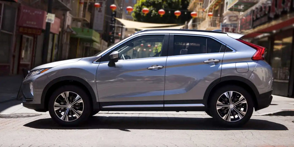 Silver Mitsubishi Eclipse Cross on the road, side view