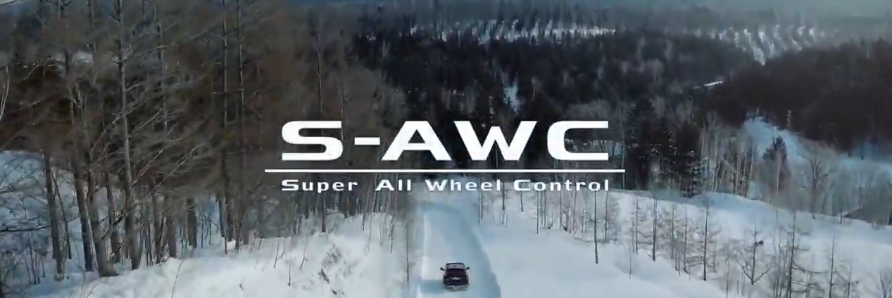 S-AWC lettering on a snowy background with an Eclipse Cross in the distance