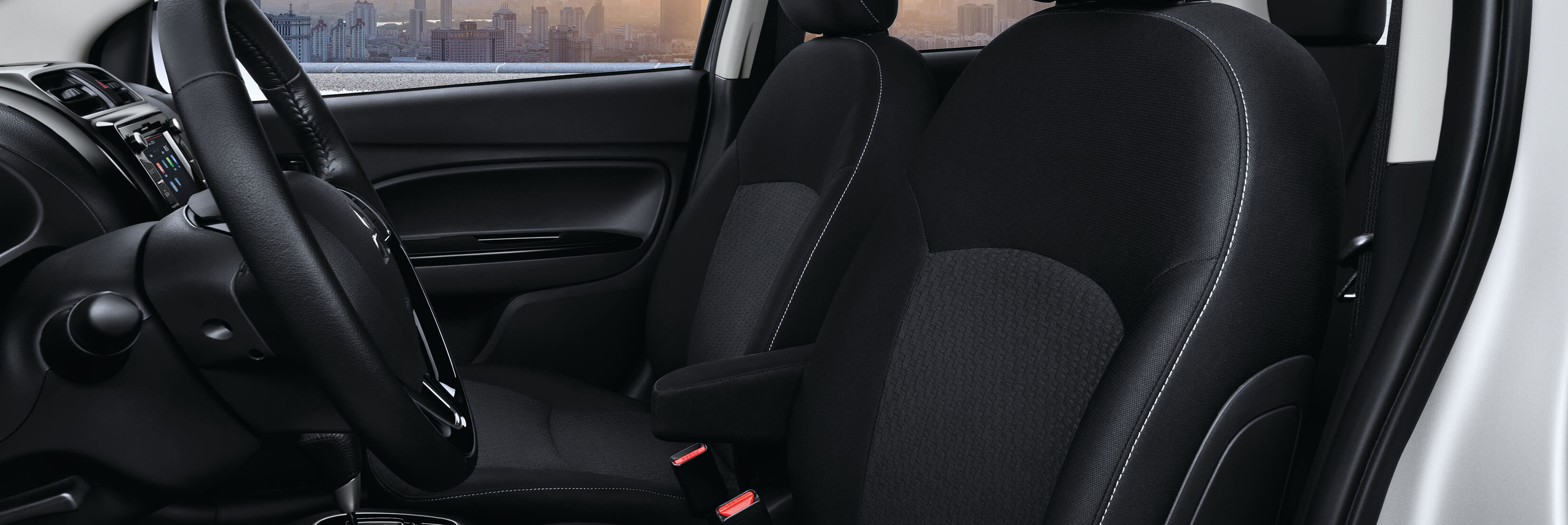 Side profile of front interior of a Mitsubishi Mirage w