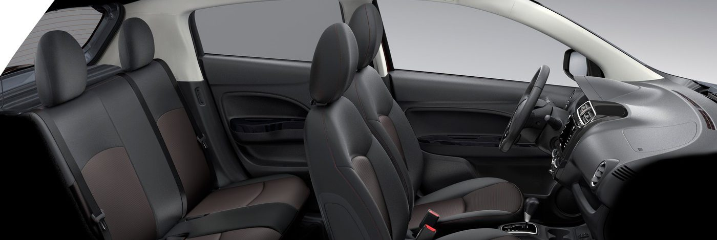 Side profile of the Mitsubishi Mirage interior with rear seats, front seats and front dashboard with steering wheel