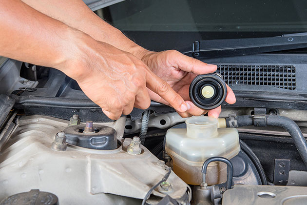 Brake Fluid check being performed by a technician