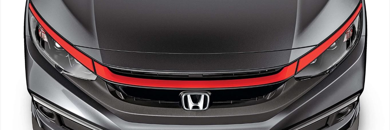 the front bumper of a grey Honda Civic with a Rally Red front grille