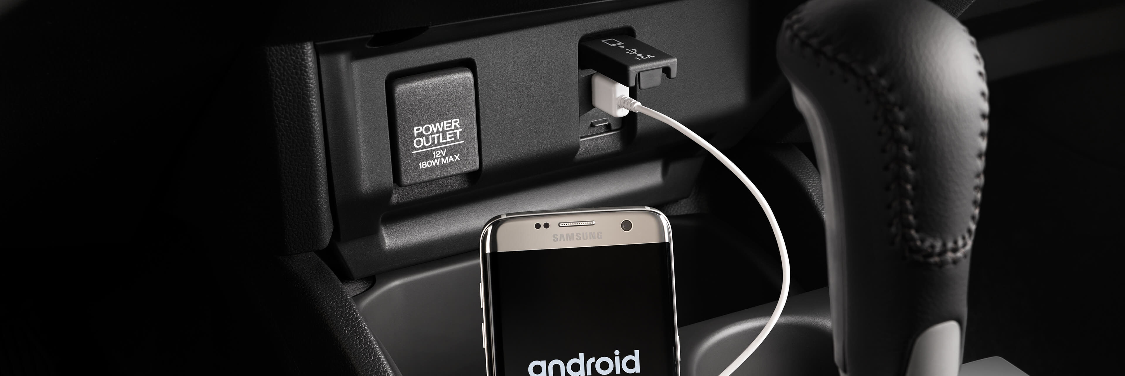 Honda Fit Interior, an Android Phone charging inside the vehicle
