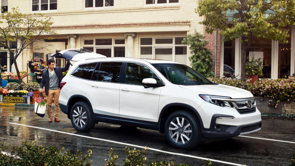 white 2019 honda pilot with man opening rear liftgate