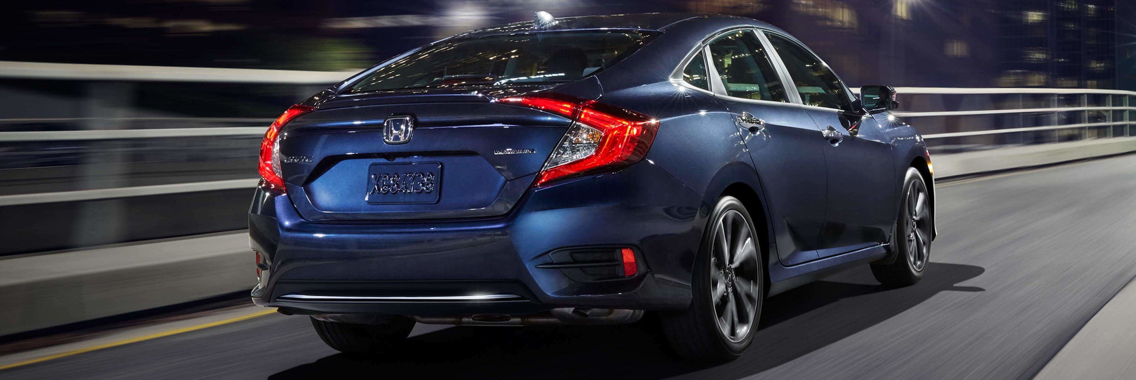 Rear of a 2019 Civic driving at night in a city