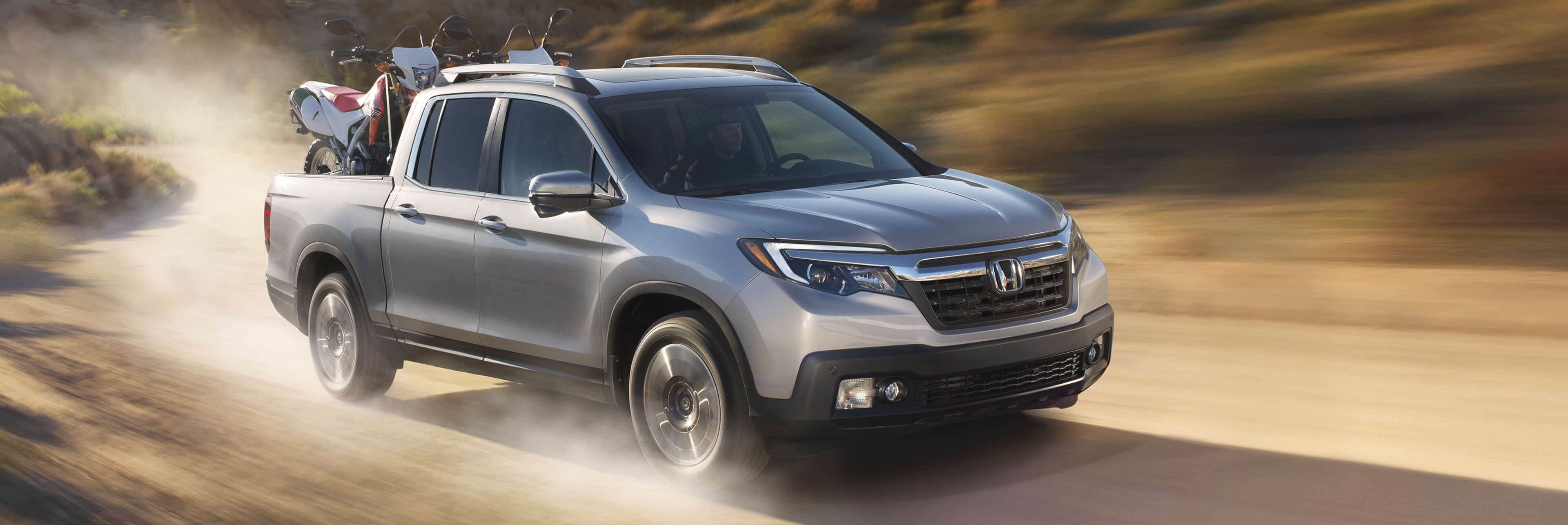 2019 Honda Ridgeline driving on a dusty country road