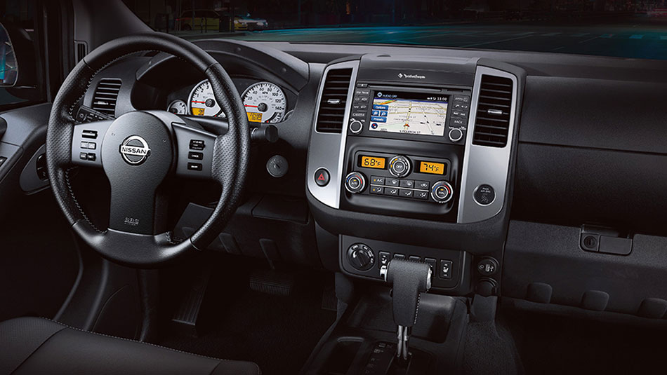 Nissan Frontier® PRO-4X® Crew Cab shown in Graphite Leather with optional equipment.