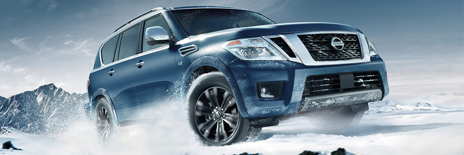 Nissan Armada driving on a snowy mountain