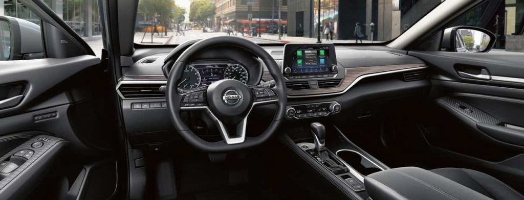 View inside the cockpit of a Nissan vehicle with the NissanConnect system displayed on the touchscreen