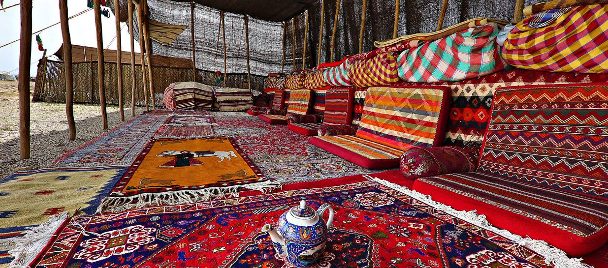inside a tent full of weavings from the Qashqai people of Iran