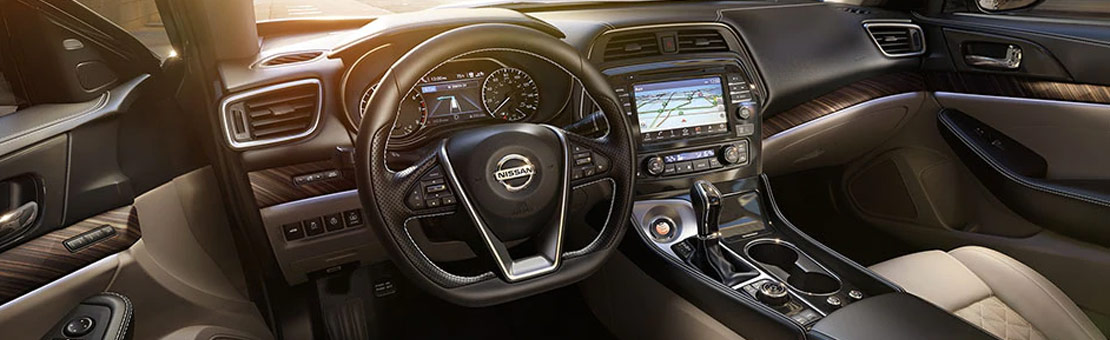2020 Nissan Maxima interior view of dashboard in Cashmere Beige Leather
