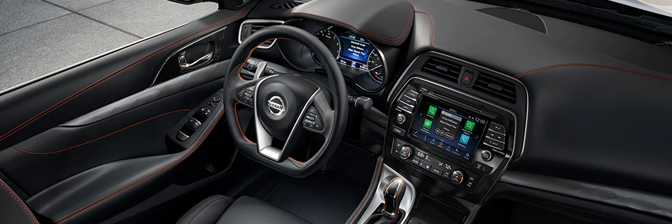 Interior downward view of the front seats and dash of the 2020 Nissan Maxima