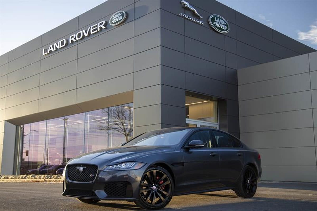 Front 3/4 view of the 2018 Jaguar XF parked outside of the dealership