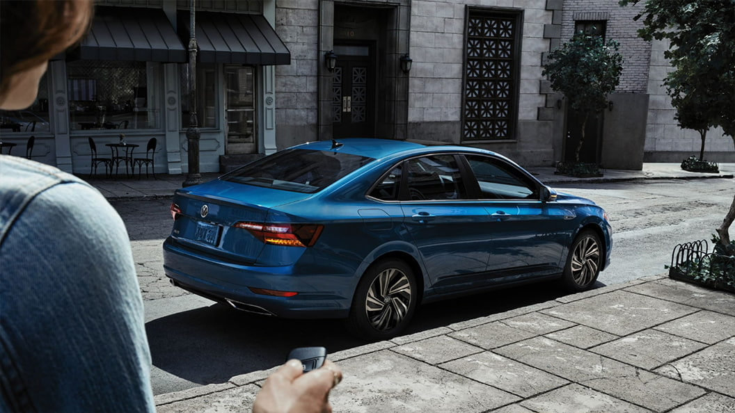 Rear 3/4 exterior view of the 2021 Volkswagen Jetta parked on the side of the street